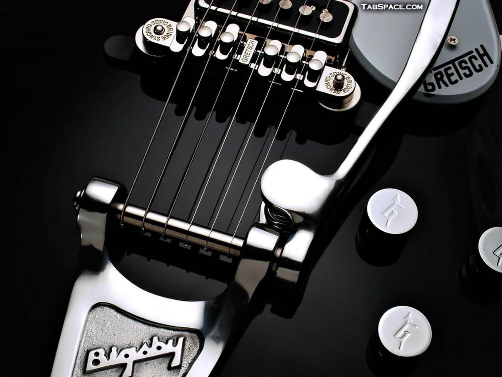 http://1.bp.blogspot.com/_nqDrJsvdPdc/SxBN6uvYo8I/AAAAAAAABDw/nRjvvny5vs4/s1600/guitar-wallpaper-11%20[1600x1200].jpg